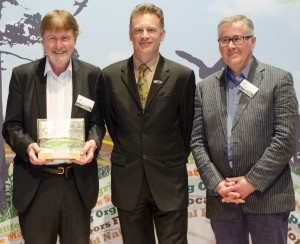 Keith shows off the award, with Tim, either side of Chris Packham